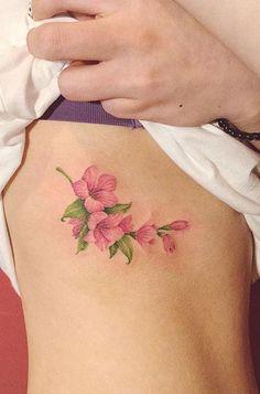 Popular beautiful watercolor pink floral rib tattoo ideas for women - ideas de tatuaje de costilla Tattoo Designs Foot, Fairy Tattoo Designs, Tattoo Designs For Women, Flower Tattoo On Side, Flower Wrist Tattoos, Tattoos For Women Flowers, Foot Tattoos For Women, Classy Tattoos, Pretty Tattoos