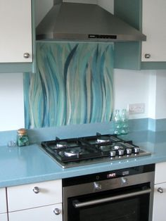 """This splashback is in """"Bluegrass"""" from our Grasses collection. This colourway is exclusive to John Lewis customers. Glass Cooker Splashback, Glass Splashbacks, Bathroom Splashback, Kiln Formed Glass, Kitchen Design, Kitchen Ideas, Grasses, Home Decor Furniture, Country Kitchen"""