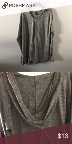 Grey hooded long sleeve tunic Almost fits as a t shirt dress 50% of the proceeds from the sale of this item will be donated to the ACLU and/or Planned Parenthood. Tops Tees - Long Sleeve