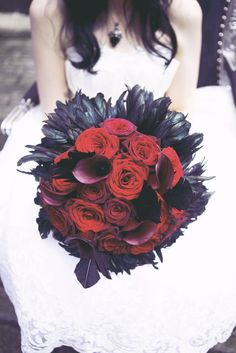 gothic bouquet. Love the feathers