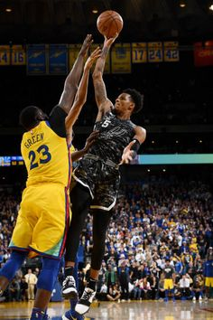 cc5b2831495 Dejounte Murray of the San Antonio Spurs shoots the ball against the Golden  State Warriors on