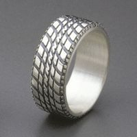Brian Bergeron makes these rings. I bought one for Brian one year for his birthday, it looks great.