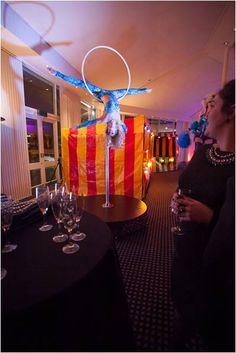 How amazing is this acrobat! Perfect act for a circus themed Christmas party.