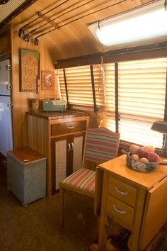 LOVE the little drop leaf table in this vintage Airstream!