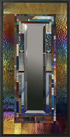 Hand cut glass piece are precisely assembled to create exquisite glass mosaic. The iridescent glass changes color with lighting conditions. Blue Parclose by Thomas Meyers: Art Glass Mirror available at www.artfulhome.com