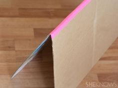 Making a collapsible playhouse out of a simple cardboard box is easier than you think