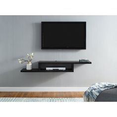 Zipcode Design Vidalia Floating TV Stand for TVs up to Colour: Black Wall Mount Tv Shelf, Wall Mount Tv Stand, Wall Mounted Tv, Tv On Wall, Mounted Tv Decor, Martin Furniture, Tv Furniture, Hooker Furniture, Floor Cable Cover