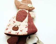 This unique Sunbonnet key holder is hand made from Japanese yarn & cotton with embroidery finished. Has key ring and leather string to pull ...