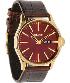 Update your style with a classy brown gator print leather band on an oxblood sunray face with gold detailing and raised bezel.