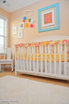 grey coral yellow nursery | pink yellow turquoise nursery with diy nursery items and faux fur rug ...