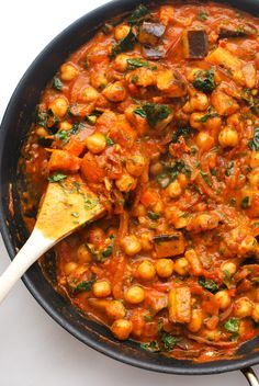 A rich and delicious curried tomato sauce packed with chickpeas, eggplant and kale for an uber healthy, coincidentally vegan weeknight meal. Best served over rice or spaghetti squash! #weeknightdinner #veganrecipe