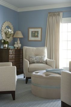 I would love a blue reading room like this. It is always a pretty color for a nursery.