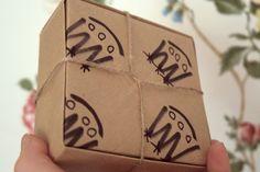Cajas origami reciclando bolsas de papel. Packaging.