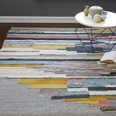 Put this one on top of the gray stiped rug for a layered look.