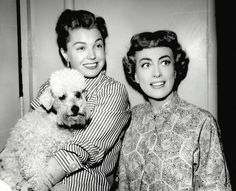 0 esther williams holding joan crawford's poodle in her arms