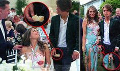 Photos of Liz Hurley and her son 'doctored to remove champagne flute'