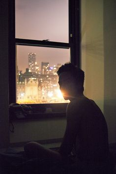 The bright lights of the city shone brightly behind him, but he couldn't bear to look at it. The city only reminded him of all the things he lost.