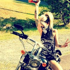 Four things I love: motorcycle, blondes, tattoos, and Jack Daniels