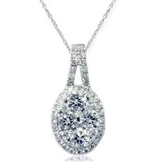 """This high quality womens pendant features 4=.32ct, and 42 =.22ct. All diamonds are set in solid 18k white gold. .55ct total diamond weight. An 18"""" 14k white gold clasp lock chain is included. - $999"""