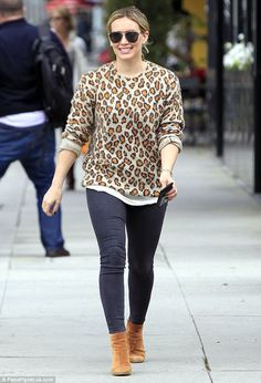 Wild about fashion! Hilary Duff looked cozy in a stylish, leopard print sweater as she ste...