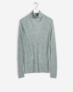 Luxe slim fitted roller in light weight tencel wool yarn. Long slim sleeves and a fine sheer quality. Wear on its own or as a layering piece. <br><br> -…