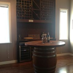 Our new wine'ing room table.... Cable spool, wine barrel, stain.