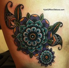 Traditional Mandala flower tattoo on ribs by Kyle Giffen.  Best tattoo shop in Austin!