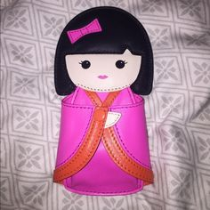 """Kate Spade """"Hello Tokyo"""" Kimmi Doll Coin Purse! Kate Spade """"Hello Tokyo"""" Kimmi Doll Coin Purse! Recently purchased as a gift but ended up purchasing something different. Gently used but in excellent condition! Leather colors: Vivid Snapdragon (pink) and Cyber Orange. Super cute coin purse dressed in a Japanese kimono. Approx 3.5""""Lx 7""""Hx1""""D. Small puncture hole on the doll's right kimono sleeve...May be from the tag placement by retail. kate spade Bags Wallets"""