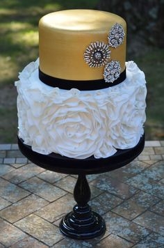 Rosette ruffle wedding cake with gold metallic and brooches  Could use this as a template for a birthday party and use different colors for a girl's birthday