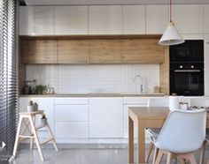 Mieszkanie Kraków,50m2. Realizacja - Mała otwarta kuchnia jednorzędowa w aneksie, styl nowoczesny - zdjęcie od STUDIO PNIAK