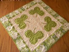 Luck of the Irish Table Topper  This includes instructions for the quilt and topper.  And it's precious!