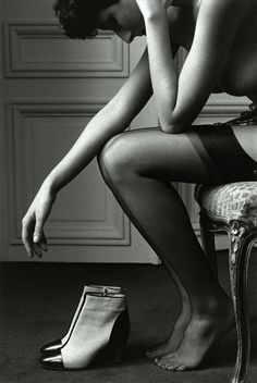 He's already snoring, fast asleep on a bourbon and rye binge, and she knows she might as well get dressed and go home. But she pauses, hesitates, wonders if she should just pour herself some as well and slide into the rumpled hotel room bed beside him...(From Le Clown Lyrique)