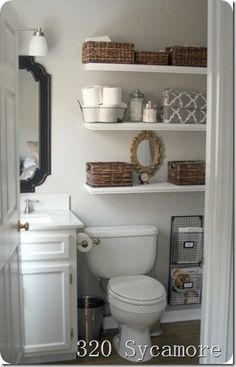 shelves in the bathroom.  cute baskets (including the wire one for the toilet paper)
