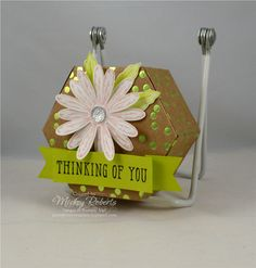 Blog Post Date:  August 23, 2017.  This hexagon box is a fun packaging option for those small gifts that might otherwise disappear among other larger boxed items.  Elements of this box include:  Window Shopping stamp set, Window Box Thinlits for the Big Shot, Daisy Delight stamp set, Daisy punch, Foil Frenzy Specialty Designer Series Paper, Clear Faceted Gems, and the colors of Lemon Lime Twist, Powder Pink, and Whisper White.