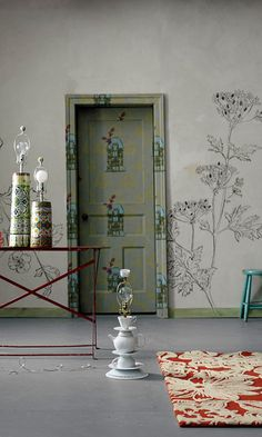 Anthropologie advert with unique wall & door. And, cool teapot lamp. Others are beautiful too.