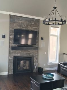 Our Prefab Panels are a great alternative to stone for fireplace surrounds. Featured here in our Stonewash Grey color.