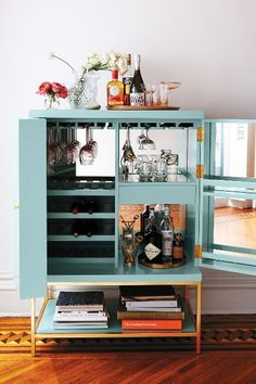 Lacquered Bar Cabinet - engineered hardwood, poplar, brass; high-gloss lacquered finish; mirrored interior w/ display-storage, wine rack, door storage; fFitted w/ brass legs, shelf support & hardware; $2k at anthropologie.com