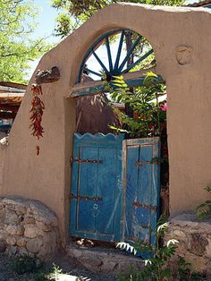 Blue gate and adobe wall in Chimayo - photographs by Linda Compton.