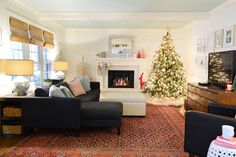 Christmas decor in our living room - we're taking you through each room for our holiday home tour, so click through to see more.