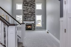 Mayfair Family Room- Eastbrook Homes, MI #NewHome #RealEstate #Fireplace #StoneFireplace #EastbrookHomes