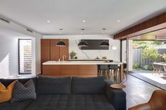 Grey ironbark veneer and matte black laminex cabinetry paried with Marmi benchtops and splashback in a contemporary extension of a cottage, by Urbane Projects. Splashback, Cottage Homes, Contemporary, Modern, Master Suite, Matte Black, Living Area, The Originals, Bedroom