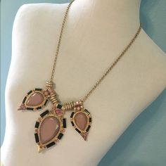 Pink and Gold Teardrop Statement Necklace Dress up your basic tee with this awesome statement necklace! 3 large teardrop pendants with blush, green, and pink gems. 29 inch chain with adjustable clasp. No trades or PayPal Cara Accessories Jewelry Necklaces