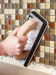 When all the tiles are in place, firmly press them onto the wall with your fingers or a clean grout float. Check that all the tiles are set evenly. Wipe off any excess thin-set mortar.