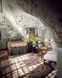 Belfry chamber at Beauport, Sleeper-McCann House. French wallpaper, semi-repeating scenic pattern of a naturalistic depiction of flowers, foliage, blooming branches, butterflies and exotic birds on a celadon green ground, 1911