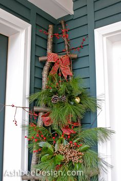 Lovely rustic ladder with greenery and berries and a bow. could work for other holidays