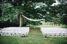 This breathtaking outdoor ceremony includes a minimally chic awning and darling flowers😍 Photo Credit: Simply Lace Photography | Event Planner: Shaw Events | Florist: Bellwood Blooms | Décor & Rentals: Simply Beautiful Decor | Venue: Kurtz Orchards