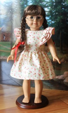 USE COUPON CODE ANNIV20 and get 20% off through June 21, 2014 Here is Molly in a her birthday dress done in a cute cherry fabric. The pattern