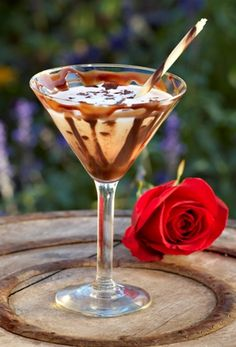 Chocolate Kiss: Ingredients; 1 1/2 ounces Stoli Vanil Vodka, 1 ounce Godiva White Chocolate Liquor, 3 ounces Cream. Directions; shake all ingredients with ice and strain. Serve in a chocolate swirled glass. Garnish with a chocolate duo stick and fresh chocolate shavings.