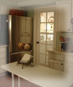 Maybe a door like this from kitchen to hallway leading to laundry room and garage door.