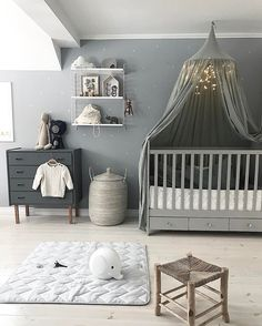 Lovely nursery room adorned by our silver grey canopy